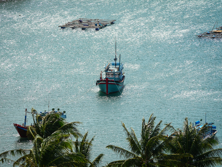 Nha Trang, Vietnam - Jan 26, 2016. A fishing boat on the sea in Nha Trang, Vietnam. Nha Trang is a coastal resort city in southern Vietnam known for its beaches, and offshore islands.