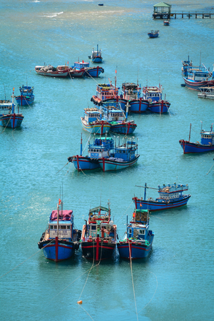 Nha Trang, Vietnam - Jan 26, 2016. Fishing boats dock on the sea in Nha Trang, Vietnam. Nha Trang is a coastal resort city in southern Vietnam known for its beaches, and offshore islands. Editöryel