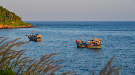 Fishing boats on the sea at sunny day in Phu Quoc Island, Vietnam.