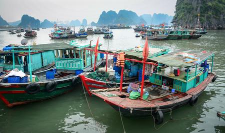 Ha Long, Vietnam - May 23, 2016. Fishing boats docking at the jetty in Ha Long, Vietnam. Ha Long, a city on Vietnam northern coast, is a jumping-off point for Ha Long Bay.