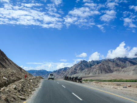 Ladakh, India - Jul 20, 2015. Motorcycles parking on the mountain road in Leh, Ladakh, India. Ladakh is one of the most sparsely populated regions in Jammu and Kashmir. Editorial