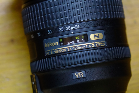Saigon, Vietnam - Jan 2, 2017. Close-up of Nikon 24-120mm AF-S lens at the shop in Saigon, Vietnam.