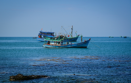 Phu Quoc, Vietnam - Dec 7, 2017. Fishing boats on the sea in Phu Quoc, Vietnam. Phu Quoc is an island off the coast of Cambodia in the Gulf of Thailand. Redactioneel