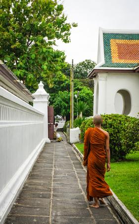 A monk walking at Buddhist temple in Bangkok, Thailand.