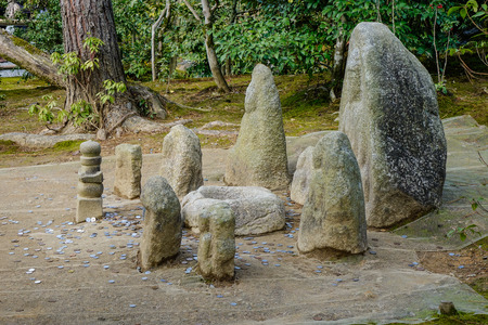Offerings to Stone Idols at Kinkakuji Temple in Kyoto, Japan.