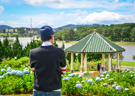 A man standing at the central park in Dalat, Vietnam. Stock Photo
