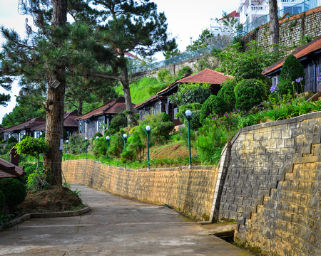 Dalat, Vietnam - Nov 25, 2017. Wooden houses of luxury resort in Dalat, Vietnam. The architecture of Dalat is dominated by the style of the French colonial period. Editorial