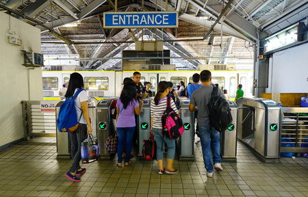 Manila, Philippines - Apr 12, 2017. People coming to LRT Station in Manila, Philippines. Manila is the capital of the Philippines and the center of governance, education and finance. Éditoriale
