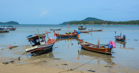 Phuket, Thailand - Jun 19, 2016. Wooden boats on Chalong Bay in Phuket, Thailand. Phuket, mountainous island in the Andaman Sea, has some of Thailand most popular beaches.