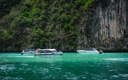 Phuket, Thailand - Jun 19, 2016. Speedboats docking on the blue sea in Phuket, Thailand. Phuket consists of the island of Phuket, and another 32 smaller islands off its coast.