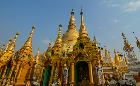 Yangon, Myanmar - Feb 26, 2016. Part of Shwedagon Pagoda at sunny day in Yangon, Myanmar. The Pagoda is believed by Buddhists to be around 2500 years old. Editorial