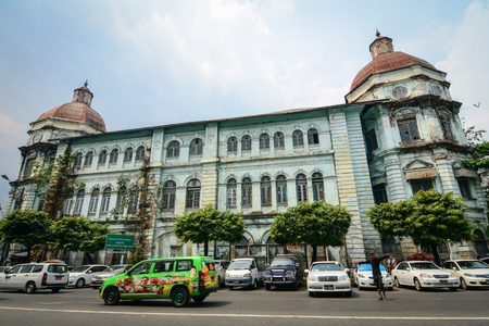 Yangon, Myanmar - Feb 26, 2016. Old buildings located at downtown in Yangon, Myanmar. Much of the architecture in downtown Yangon dates from the period of British rule. Editorial