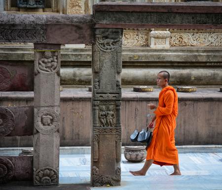 Bodhgaya, India - Jul 9, 2015. A monk walking at Mahabodhi Temple in Bodhgaya, India. Mahabodhi marking the spot of the Buddha enlightenment.
