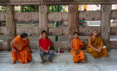 Bodhgaya, India - Jul 9, 2015. People praying at Mahabodhi Temple in Bodhgaya, India. Bodh Gaya is considered one of the most important Buddhist pilgrimage sites.