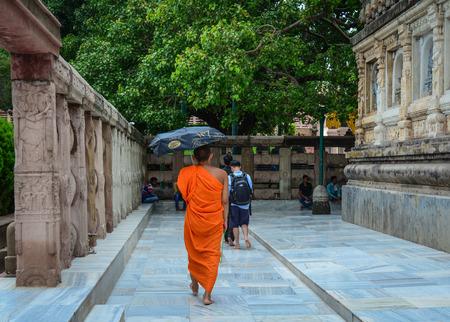 Bodhgaya, India - Jul 9, 2015. A monk walking at Mahabodhi Temple in Bodhgaya, India. Bodh Gaya is considered one of the most important Buddhist pilgrimage sites.
