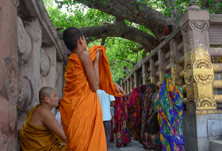 Bodhgaya, India - Jul 9, 2015. Buddhist monks at Mahabodhi Temple in Bodhgaya, India. Bodh Gaya is considered one of the most important Buddhist pilgrimage sites. Editorial