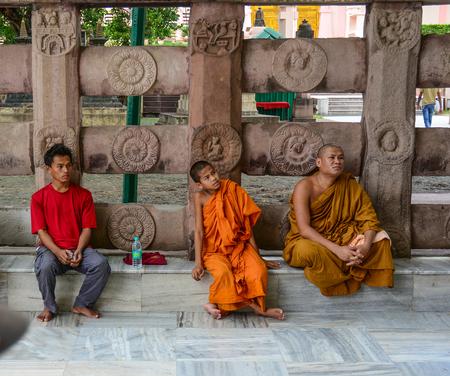 Bodhgaya, India - Jul 9, 2015. People sitting at Mahabodhi Temple in Bodhgaya, India. Bodh Gaya is considered one of the most important Buddhist pilgrimage sites.