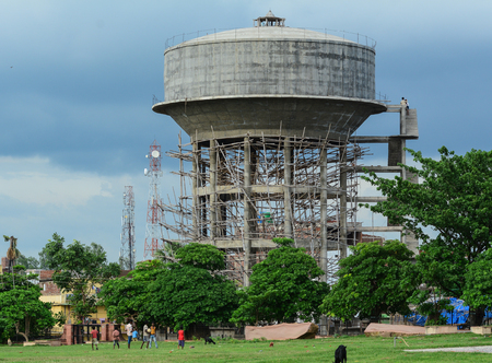 Bodhgaya, India - Jul 9, 2015. Water tower under construction in Bodhgaya, India. Bodh Gaya is considered one of the most important Buddhist pilgrimage sites.