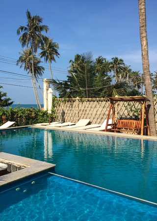 Phan Thiet, Vietnam - Apr 6, 2016. Swimming pool of luxury hotel in Phan Thiet, Vietnam. Phan Thiet encompasses a 57.4-km-long coastline with many beaches Editorial