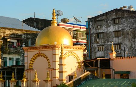 Yangon, Myanmar - Jan 14, 2015. Old buildings with golden dome in Yangon downtown, Myanmar. Yangon is the biggest city in Myanmar with population over 4 million people.