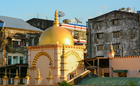 Yangon, Myanmar - Jan 14, 2015. Old buildings with golden dome in Yangon downtown, Myanmar. Yangon is the biggest city in Myanmar with population over 4 million people.