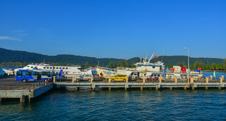 Phu Quoc, Vietnam - Dec 16, 2017. Highspeed ferries docking at pier in Phu Quoc Island, Vietnam. Phu Quoc is a Vietnamese island off the coast of Cambodia in the Gulf of Thailand. Stock Photo - 93181113