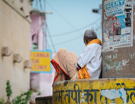 Varanasi, India - Jul 12, 2015. A man sitting on street in Varanasi, India. Varanasi is the holiest of the seven sacred cities (Sapta Puri) in Buddhism, Hinduism and Jainism.