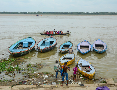Varanasi, India - Jul 12, 2015. Wooden boats docking at tourist jetty in Varanasi, India. Varanasi is the holiest of the seven sacred cities (Sapta Puri) in Buddhism, Hinduism and Jainism. Editorial