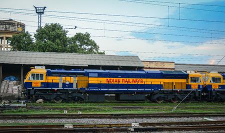 Varanasi, India - Jul 12, 2015. A train coming to railway station in Varanasi, India. Varanasi is the holiest of the seven sacred cities (Sapta Puri) in Buddhism, Hinduism and Jainism.