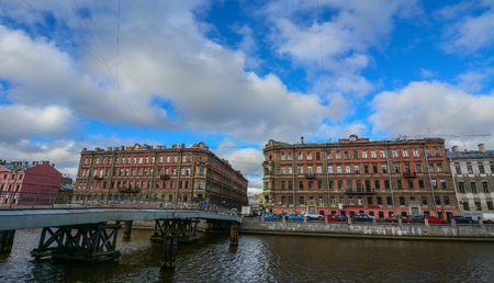 St Petersburg, Russia - Oct 7, 2016. Old buildings with Griboedov Canal at sunny day in Saint Petersburg, Russia. Saint Petersburg has a significant historical and cultural heritage.
