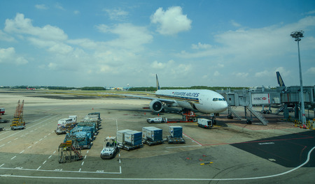 Singapore - Mar 14, 2016. An aircraft docking at Singapore Changi Airport. The Changi Airport is one of the largest transportation hubs in Southeast Asia.