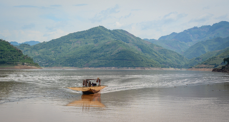 A motorboat running on Da River in Northern Vietnam. Stock Photo