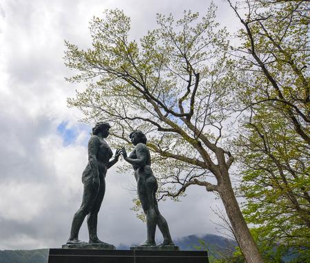 Aomori, Japan - May 16, 2017. Statue of Maiden at Lake Towada in Aomori, Japan. Lake Towada (Towada-ko) is the largest crater lake in Honshu island. 報道画像