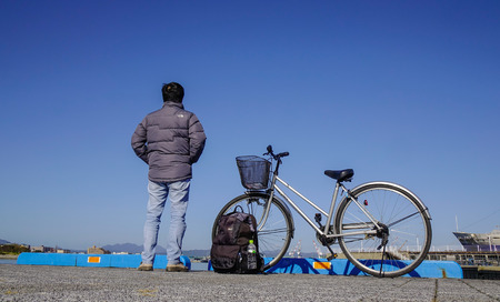 Hakodate, Japan - Oct 1, 2017. A traveler with bicycle at Port of Hakodate, Japan. Hakodate opened its gates to the world as Japan first international trade port in 1859. Editorial