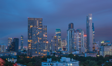 Bangkok, Thailand - Jun 19, 2017. Business district at night in Bangkok, Thailand. Bangkok is the economic centre, and the heart of the country investment and development. Editorial