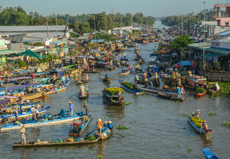 Soc Trang, Vietnam - Feb 2, 2016. People with boats at floating market on Mekong River in Soc Trang, Vietnam. Mekong is the world 12th-longest river and the 7th-longest in Asia.