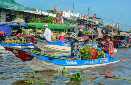 Soc Trang, Vietnam - Feb 2, 2016. People at floating market on Mekong River in Soc Trang, Vietnam. Mekong is the longest river in Southeast Asia, the 7th longest in Asia.