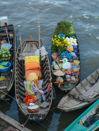 Soc Trang, Vietnam - Feb 2, 2016. Wooden boats at market on Mekong River in Soc Trang, Vietnam. Mekong is the world 12th-longest river and the 7th-longest in Asia. Editorial