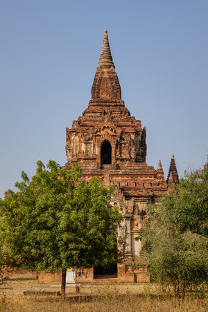 An ancient Buddhist temple at sunny day in Bagan, Myanmar.