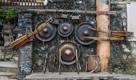 Sapa, Vietnam - Sep 20, 2013. Traditional gongs for sale on street in Sapa, Northern Vietnam. Sa Pa is a town in northwest Vietnam not far from the Chinese border.