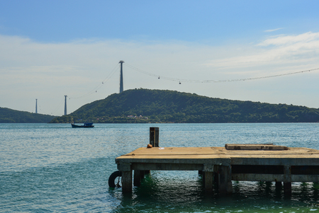Old bridge with blue sea in Phu Quoc Island, Vietnam. Stock Photo