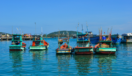 Phu Quoc, Vietnam - Dec 7, 2017. Wooden boats docking at pier in Phu Quoc, Vietnam. Phu Quoc is an island off the coast of Cambodia in the Gulf of Thailand. Editorial