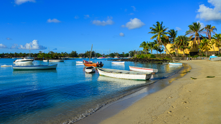 Mahebourg, Mauritius - Jan 9, 2017. Speedboats on beautiful beach in Mahebourg, Mauritius. Mauritius is a major tourist destination, ranking 3rd in the region. Editorial