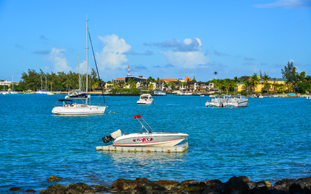 Grand Baie, Mauritius - Jan 9, 2017. Speedboats on blue sea in Grand Baie, Mauritius. Mauritius received the World Leading Island Destination award for the 3rd time in 2012.