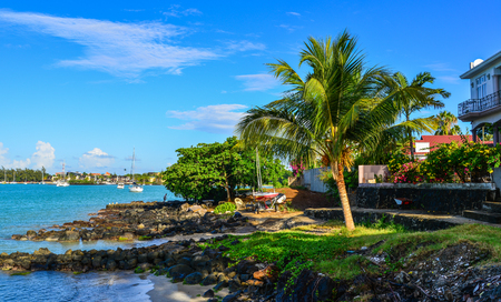 Grand Baie, Mauritius - Jan 9, 2017. Seaside houses in Grand Baie, Mauritius Island. Mauritius is a major tourist destination, ranking 3rd in the region. Editoriali