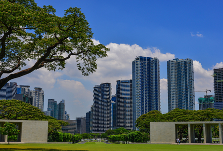 Manila, Philippines - Apr 13, 2017. Manila American Cemetery and Monument with cityscape. Cemetery honors the American and allied servicemen who died in World War II. Editorial