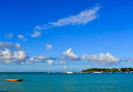 Grand Baie, Mauritius - Jan 9, 2017. Boats on sea in Grand Baie, Mauritius. Mauritius received the World Leading Island Destination award for the 3rd time in 2012.