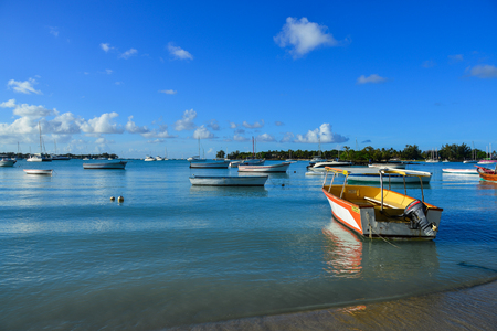 Mahebourg, Mauritius - Jan 9, 2017. Speedboats on beach under clear sky in Mahebourg, Mauritius. Mauritius is a major tourist destination, ranking 3rd in the region.
