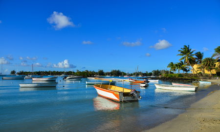 Mahebourg, Mauritius - Jan 9, 2017. Speedboats on beach in Mahebourg, Mauritius. Mauritius is a major tourist destination, ranking 3rd in the region. Editorial