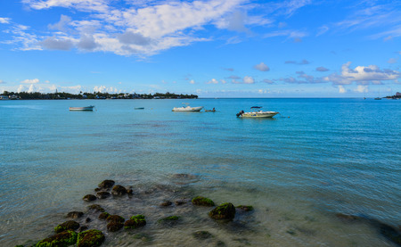 Grand Baie, Mauritius - Jan 9, 2017. Speedboats docking in Grand Baie, Mauritius. Mauritius, an Indian Ocean island nation, is known for its beaches, lagoons and reefs.